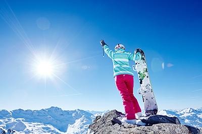 bigstock-Back-view-of-female-snowboarde-109387592_small.jpg